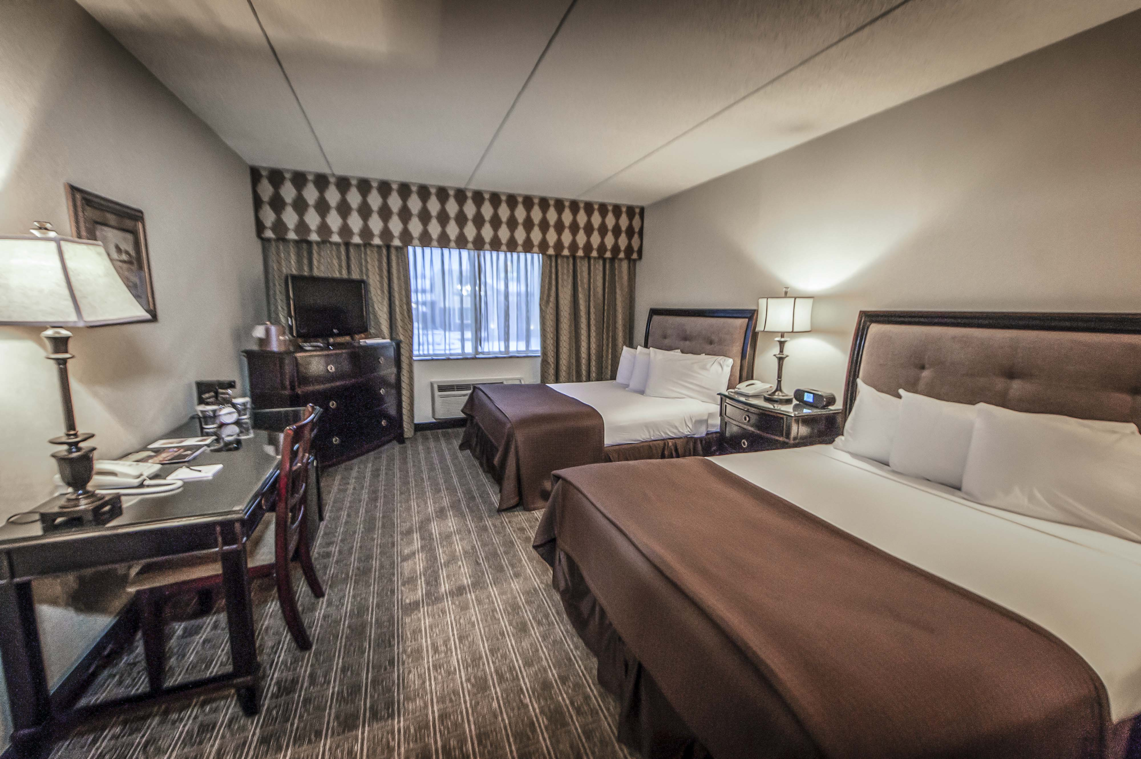 place is the about travelers comfortable both spacious us stylish accommodation holiday uniquely offering a and to business garden hotel